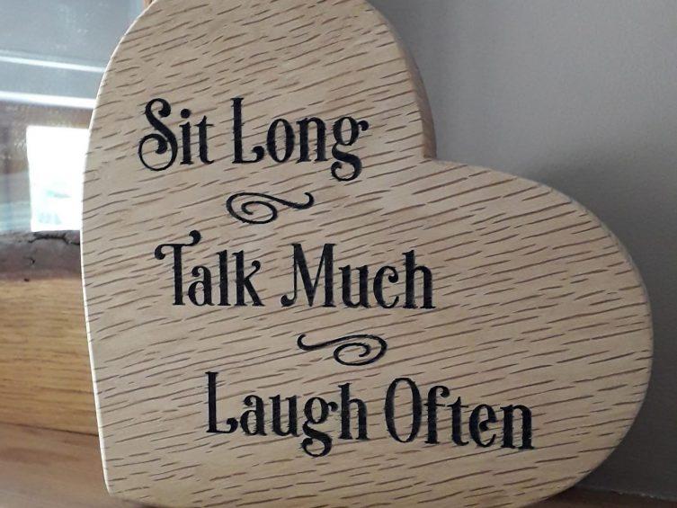 Engraved Solid Oak Heart  – Sit Long Talk Much Laugh Often